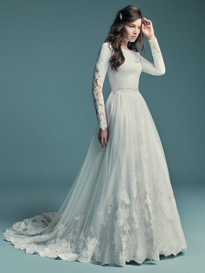 Bride Wearing Long Sleeve Sheath Wedding Gown with Detachable Overskirt Called Olyssia by Maggie Sottero