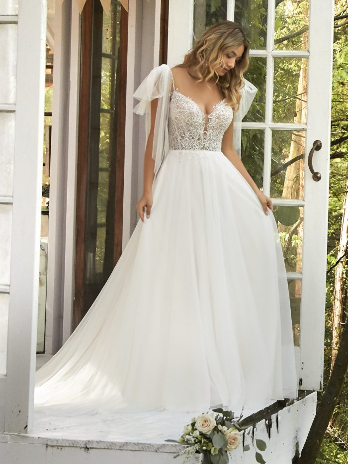 Bride Wearing Fairytale Boho Wedding Dress with Detachable Bows on the Straps Called Greta by Rebecca Ingram