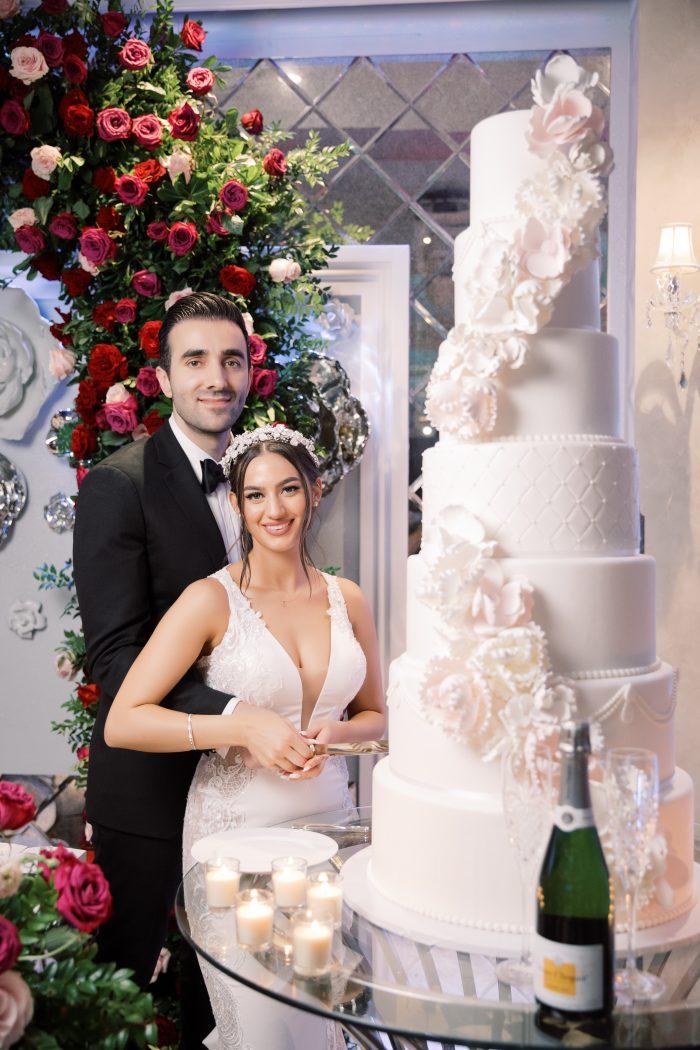 Armenian Couple at Wedding Reception with Tall White Luxurious Wedding Cake