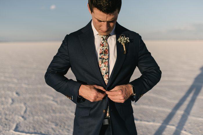 Real Groom Wearing Dark Blue Woven Suit with Wildflower Pink Tie