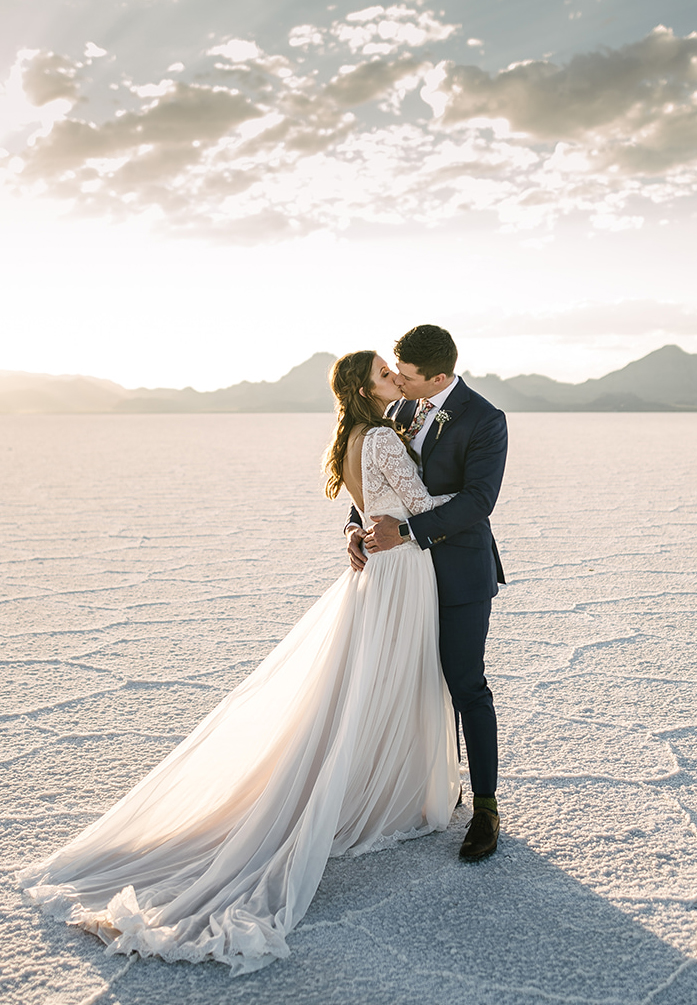 Groom with Real Bride Wearing Lace Sleeve Wedding Dress Called Deirdre by Maggie Sottero