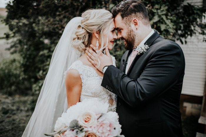 Groom Wearing Black Suit with Real Bride Wearing Backless Wedding Dress Called Wyatt by Sottero and Midgley