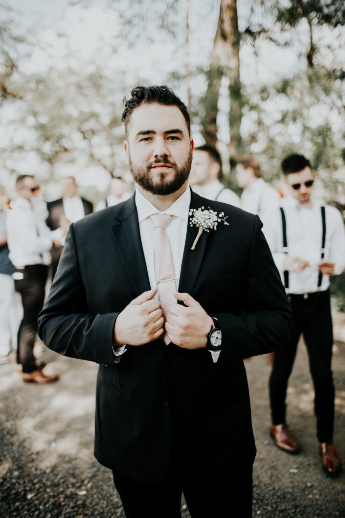 Real Groom at Real Wedding Wearing Pink Tie and Black Suit
