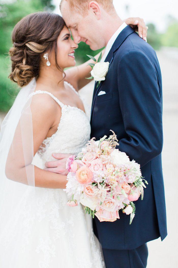 Real Bride Wearing Rebecca Ingram Wedding Dress Called Allison with Groom Wearing Dark Blue Suit and White Tie