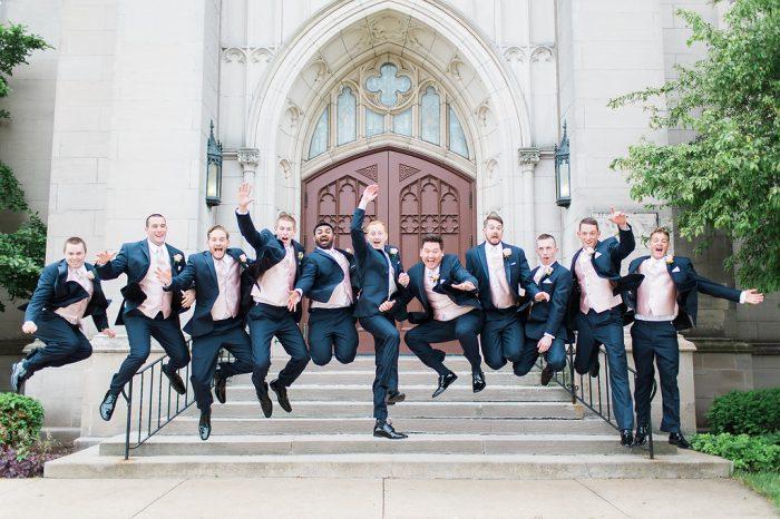 Real Groom and Groomsmen Taking Wedding Photos Wearing Classic Dark Blue Suits
