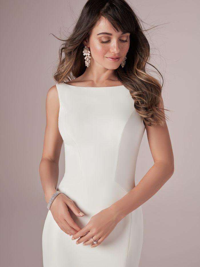 Model Wearing Simple Crepe Wedding Gown Called Alice by Rebecca Ingram