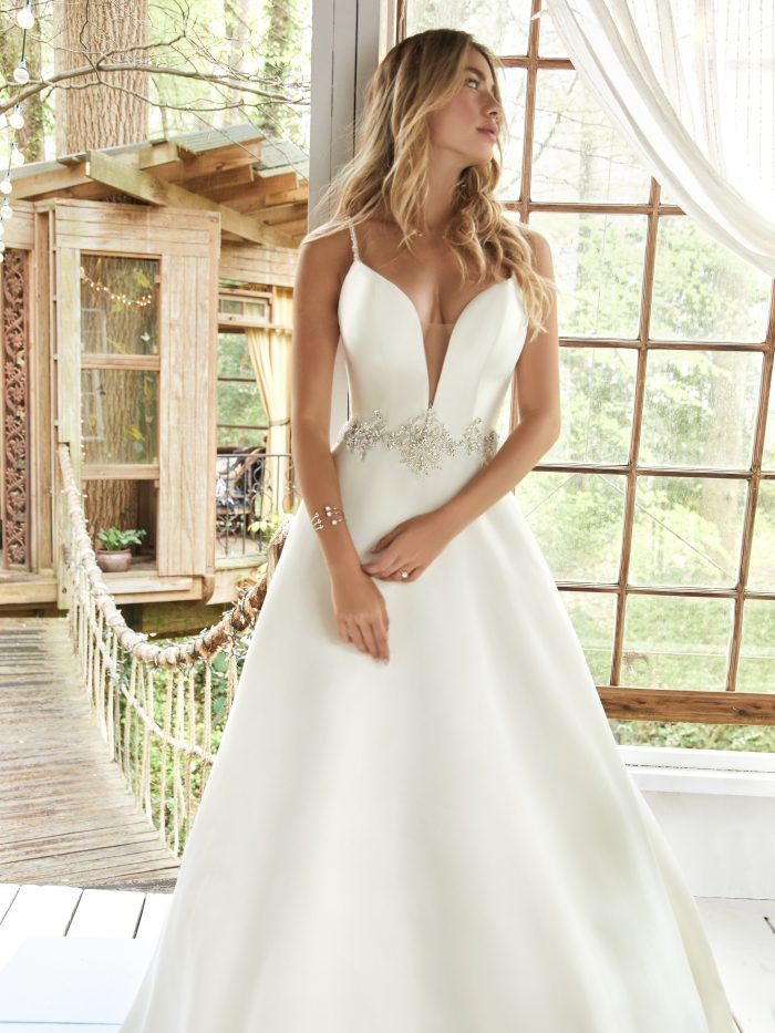 Model in House Wearing Satin A-line Bridal Gown Called Yara by Rebecca Ingram