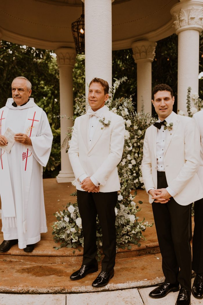 Real Groom at Wedding Ceremony Wearing White Coatsuit with Black Pants