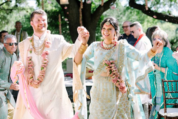 Real Bride and Groom at Traditional Indian Wedding Wearing Sherwani