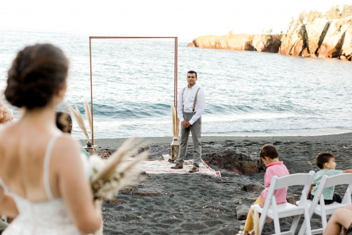 Bride Walking Down the Aisle at Beach Elopement While Groom Waits at the End