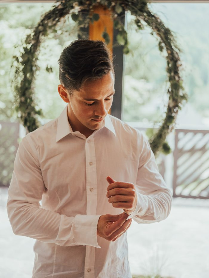Real Groom Buttoning Up White Shirt Sleeves at Real Wedding