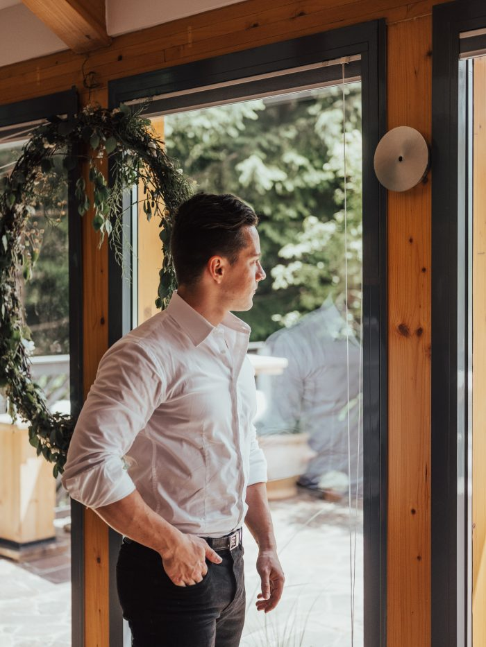 Real Groom Wearing Casual Grooms Wedding Attire with White Shirt and Black Jeans