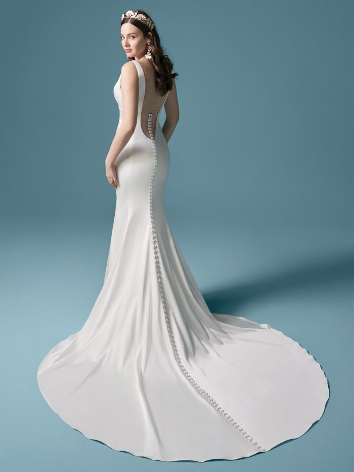 Model Wearing Crepe Sheath Wedding Dress with Long Train Called Anissa by Maggie Sottero
