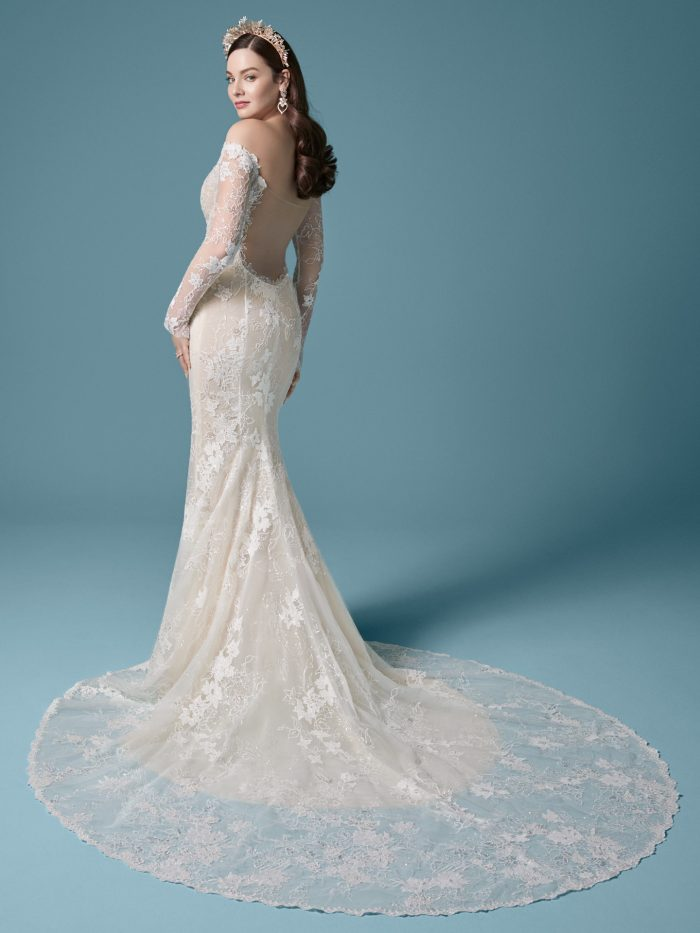 Model Wearing Off-the-Shoulder Backless Sheath Wedding Dress Called Emiliano by Maggie Sottero