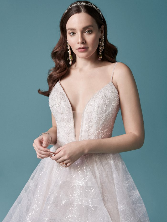 Model Wearing Princess Sequin Ball Gown Wedding Dress Called Tavi Made by Maggie Sottero