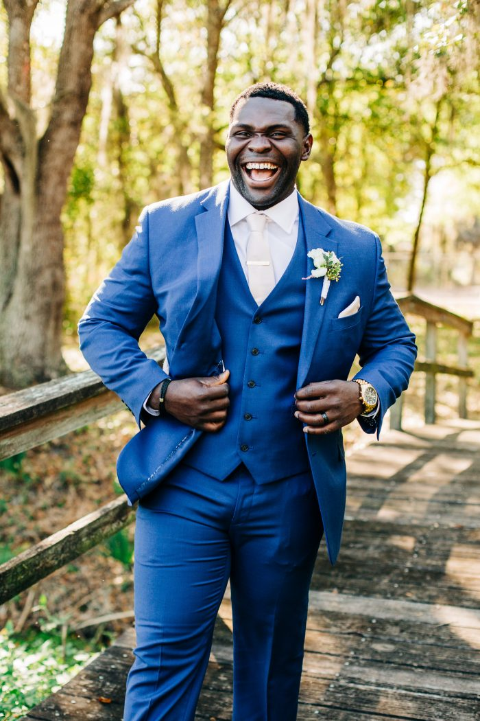Haitian Groom Wearing Blue Suit with Lavender Accents for Spring Wedding