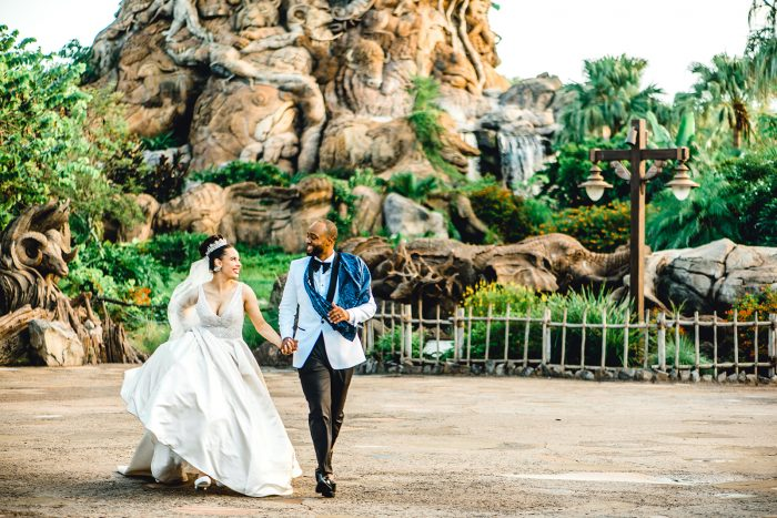 Real Couple Running Through Disney's Animal Kingdom Park After Getting Married