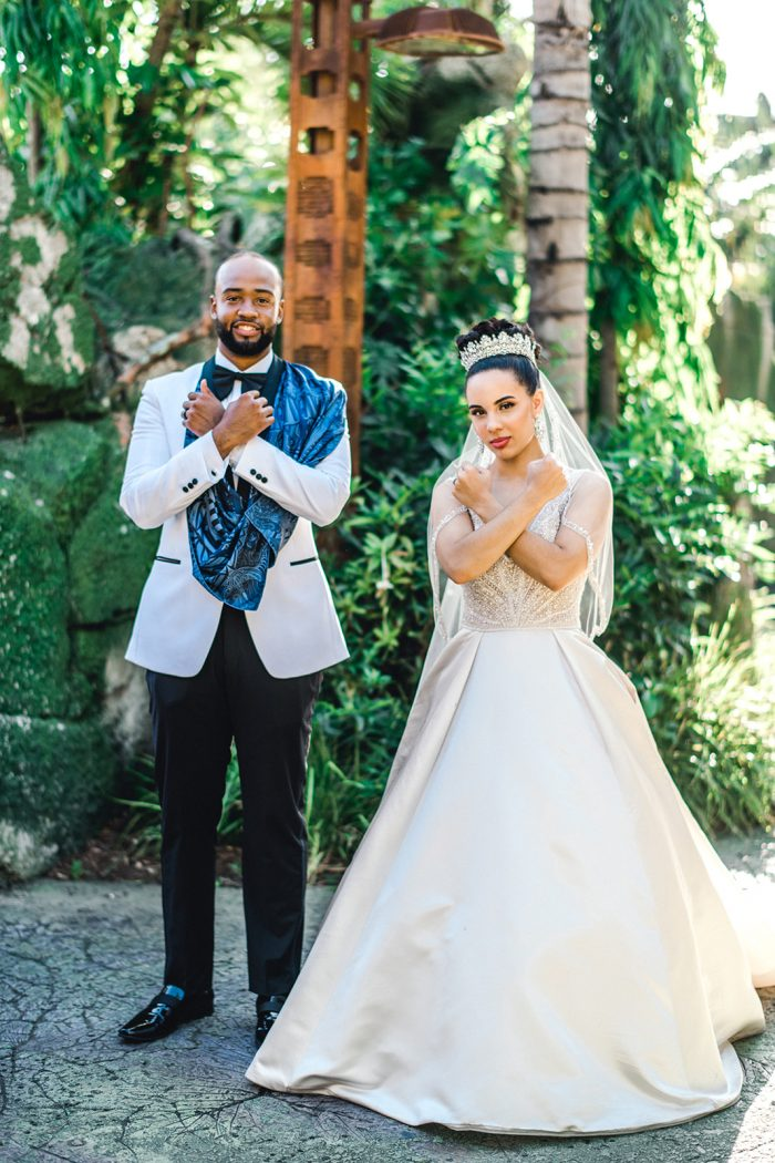 Groom with Real Bride Wearing Princess Ball Gown Wedding Dress by Maggie Sottero in Disney's Animal Kingdom