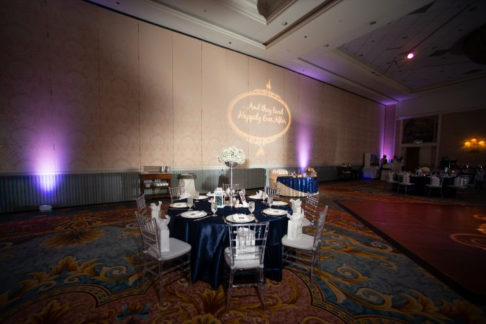 Party Favors and Disney Themed Dining Table at Fairytale Wedding Reception