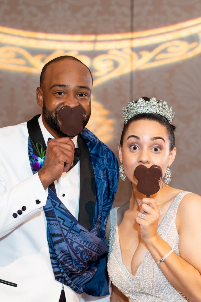Groom with Real Bride at the Grand Floridian Eating Mickey Ice Cream Bars During Their Reception