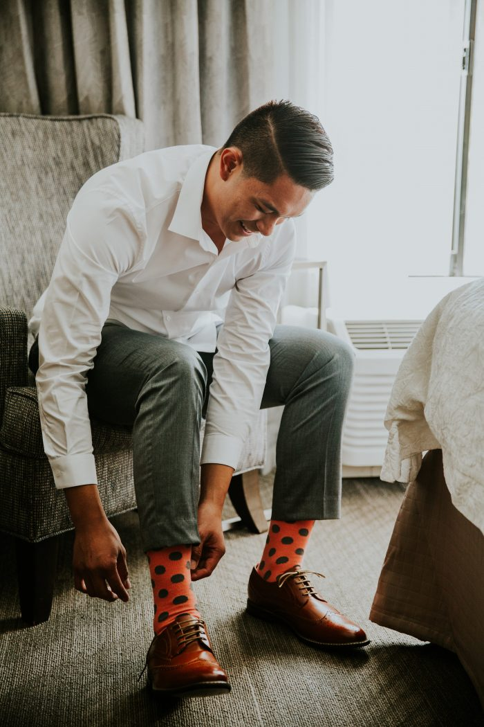 """Groom Putting on """"Cold Feet"""" Socks That Are a Wedding Gift Idea for Groom"""