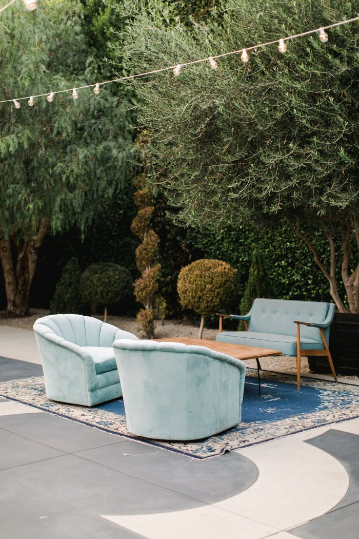 Blue Cushioned Seats for Guests at Outdoor Reception