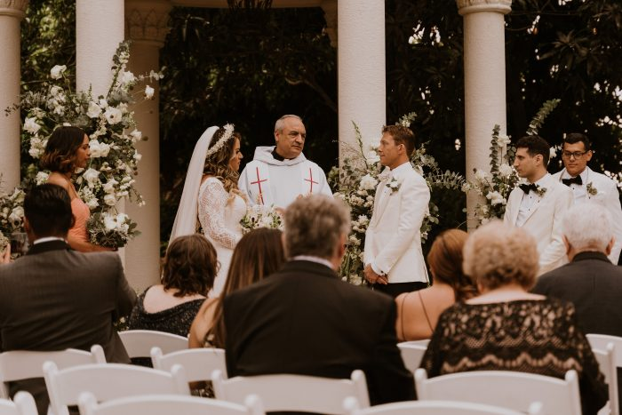 Groom with Real Bride and Officiant Social Distancing with Guests During Covid Wedding
