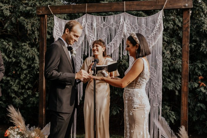 Bride and Groom Saying Vows During Intimate Backyard Elopement