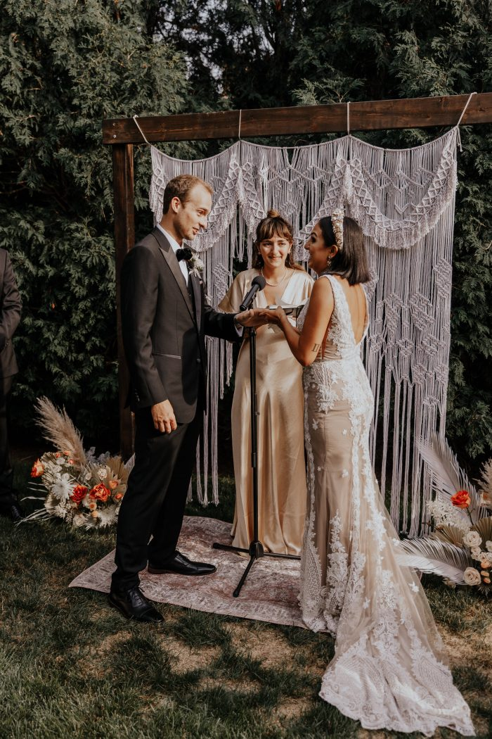 Groom with Real Bride Saying Vows While the Bride's Sister Officiates Wedding Ceremony