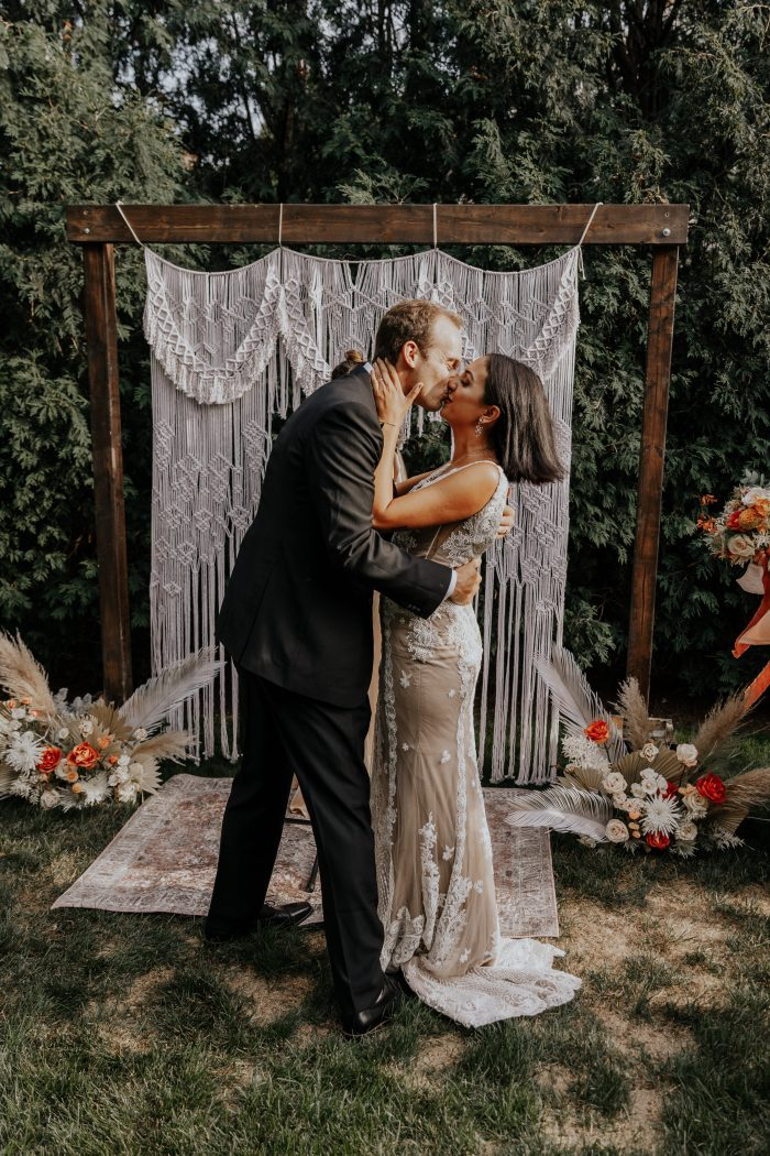 Bride and Groom Kissing After Ceremony at Intimate Backyard Elopement