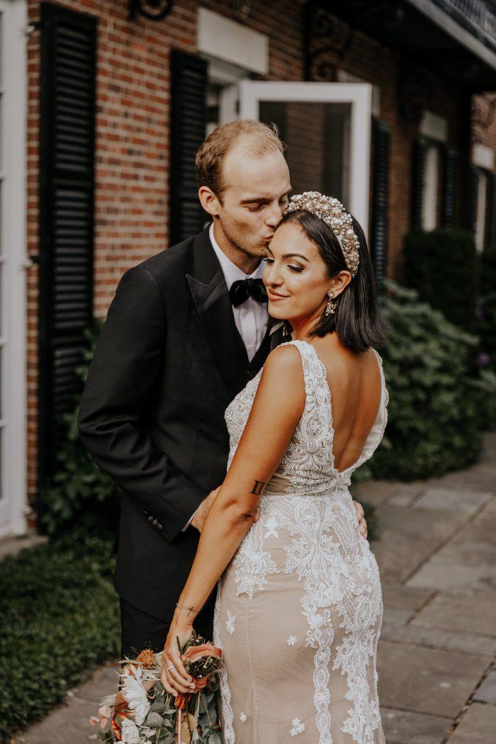 Groom Kissing Bride Wearing V-back Sheath Wedding Dress Called Agata Louise by Sottero and Midgley