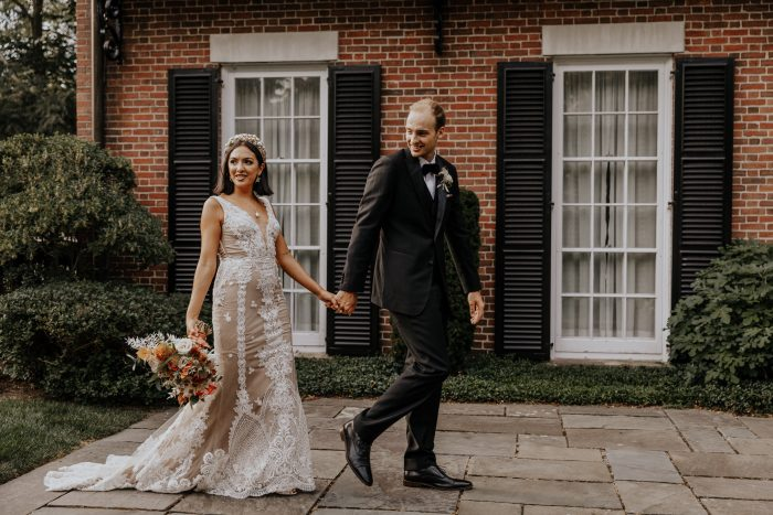 Groom Walking with Bride Wearing Lace Sheath Wedding Dress Called Agata Louise by Sottero and Midgley
