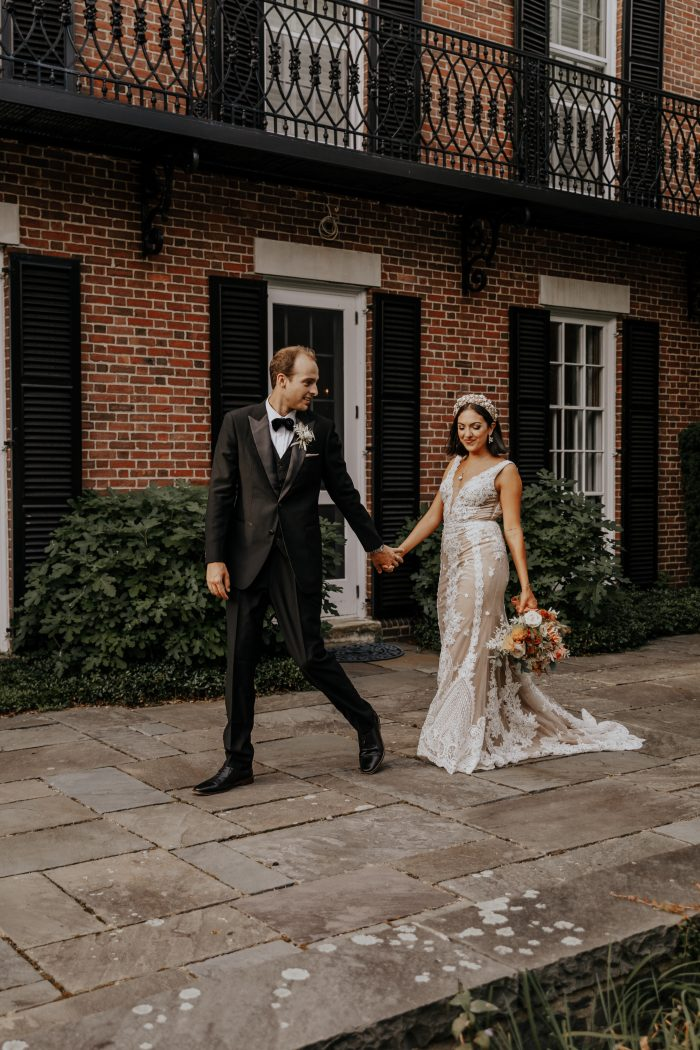 Groom Walking with Real Bride Wearing Boho-Chic Wedding Dress Called Agata Louise by Sottero and Midgley