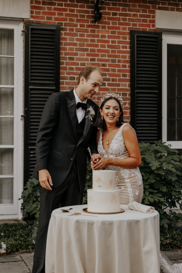 Groom with Real Bride Cutting Wedding Cake at Backyard Elopement