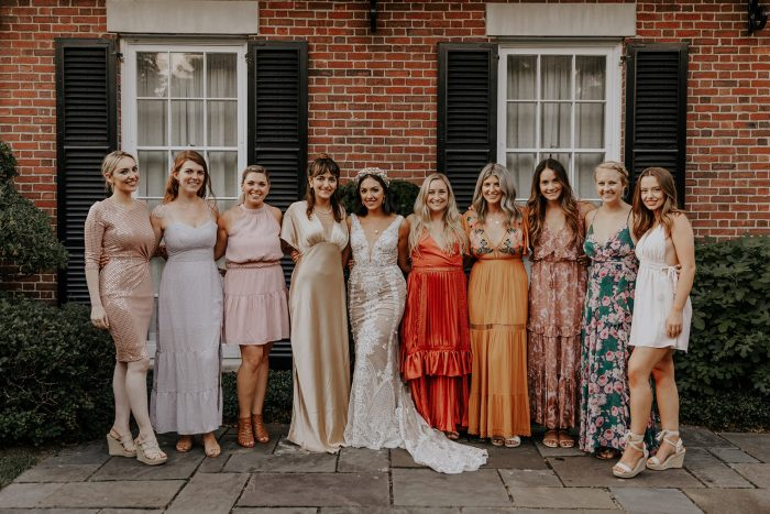 Real Bride Wearing Boho Wedding Dress Surrounded by Bridesmaids Wearing Mismatching Dresses