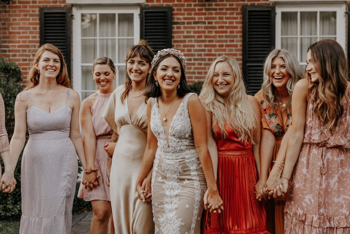 Real Bride Wearing Boho Wedding Dress with Bridesmaids Wearing Colorful Mismatched Dresses