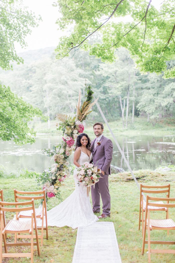 Bride and Groom Under Triangle Wedding Arch Waiting for Guests to Show Up to Their Outdoor Micro Wedding