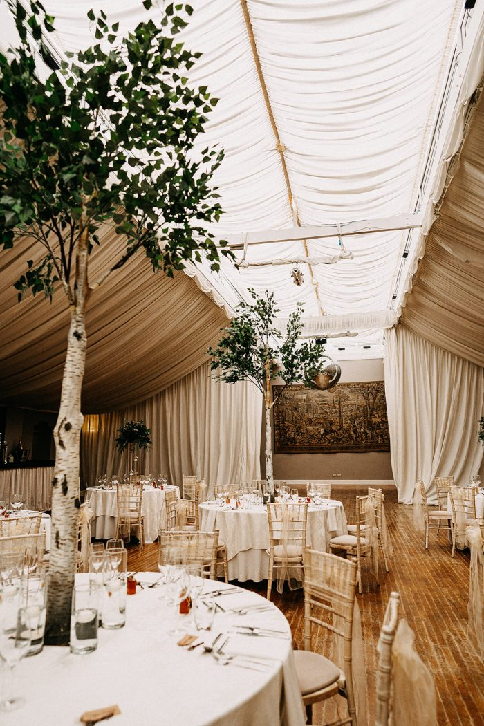 Indoor Venue with Trees and Boho Wedding Details