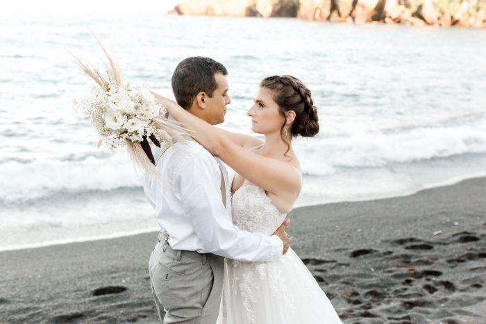 Groom Looking at Bride Wearing Boho Beach Wedding Dress Called Stevie by Maggie Sottero