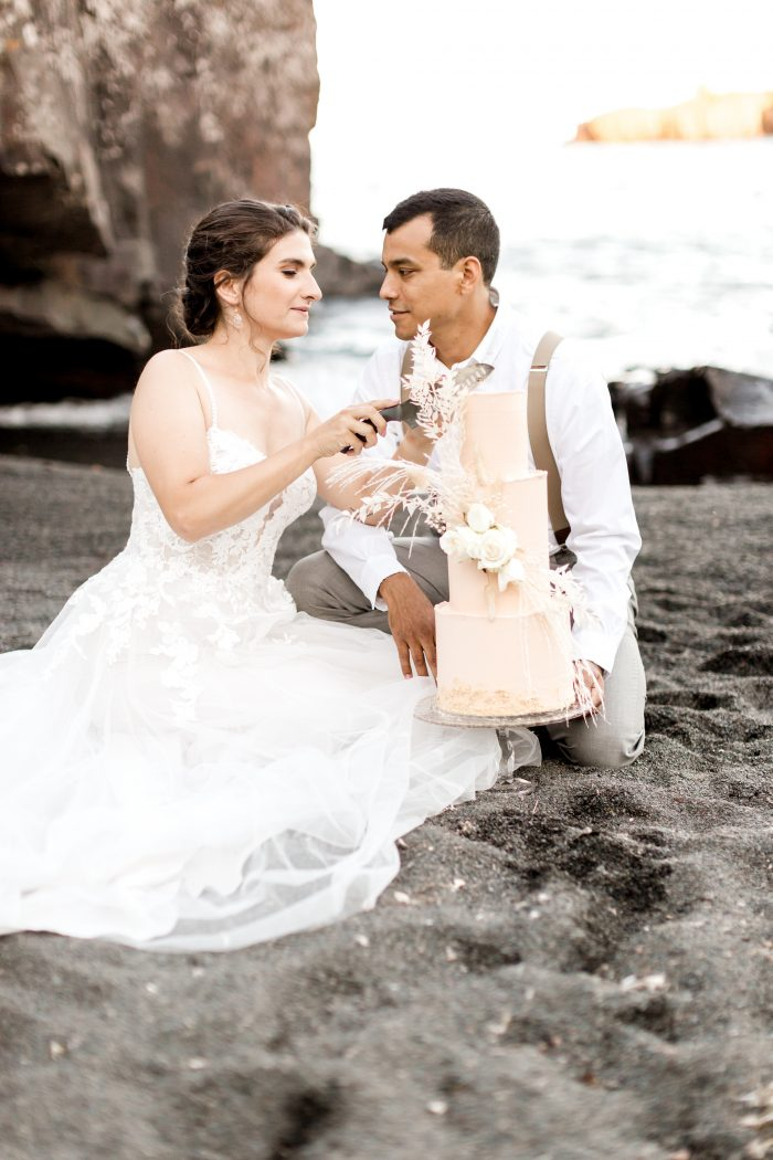 Bride and Groom at Intimate Beach Elopement Cutting Cake