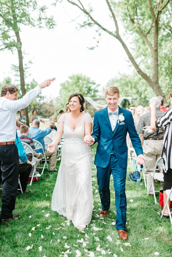Bride and Groom Walking Down the Aisle While Guests Cheer After Ceremony at Micro Wedding