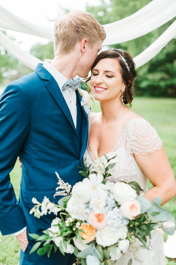 Groom with Bride Wearing Vintage Sheath Wedding Dress Called Ettia by Maggie Sottero