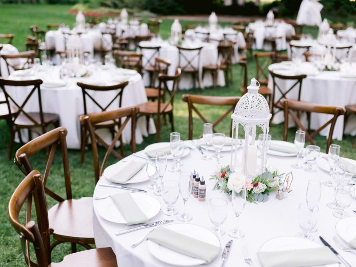 White DIY Lantern Table Settings at Outdoor Wedding
