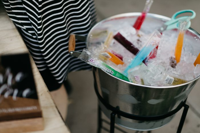 Metal Bucket Filled with Ice and Otter Pops for Outdoor Summer Wedding