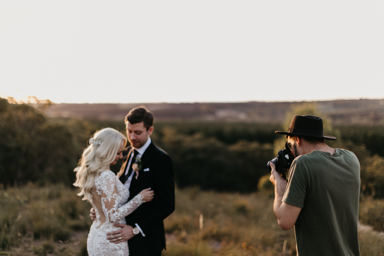 Bride and Groom Being Photographed in the Mountains by Wedding Photographer