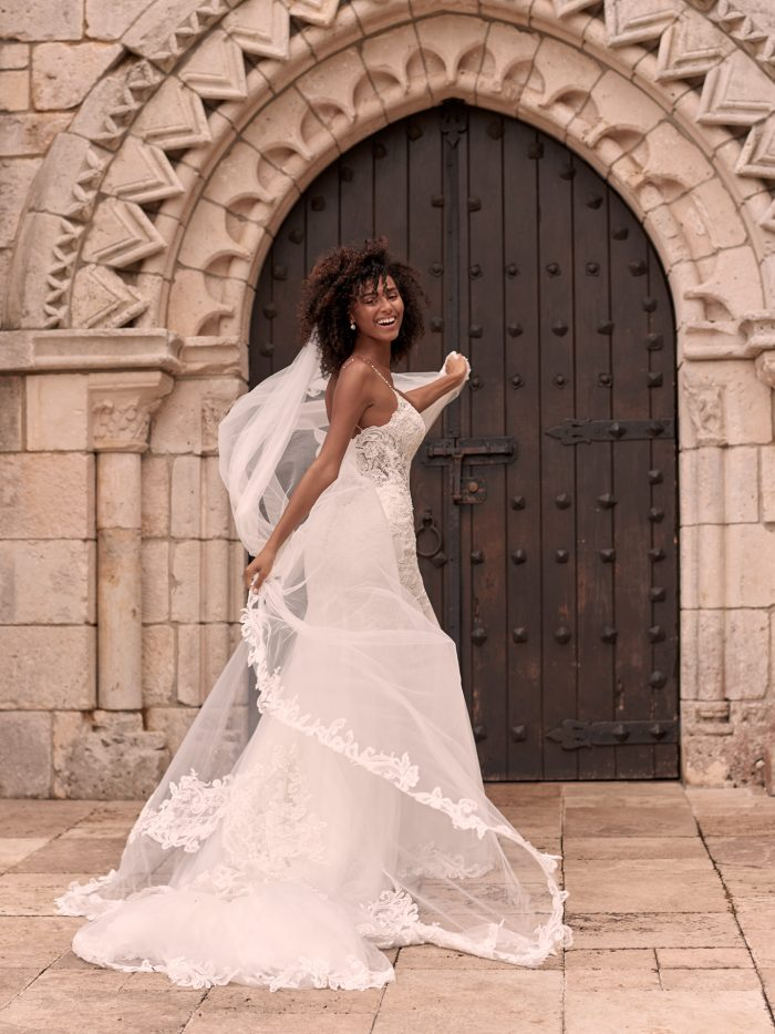 Black Model Running with Cathedral Wedding Veil Trimmed in Lace by Maggie Sottero