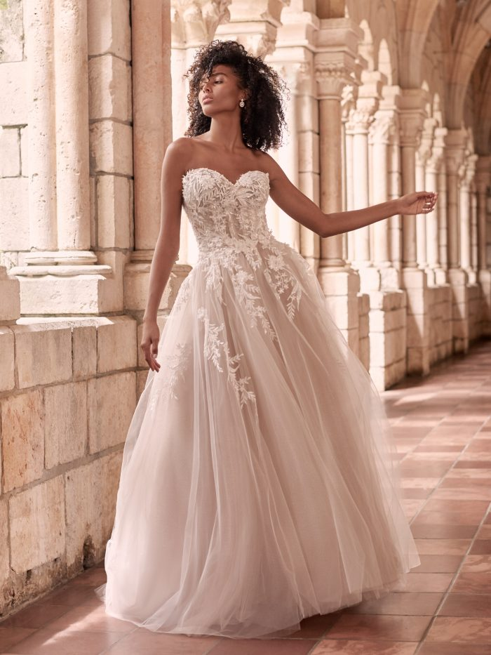 Black Model Wearing Dreamy Ball Gown Wedding Dress Called Orlanda by Maggie Sottero
