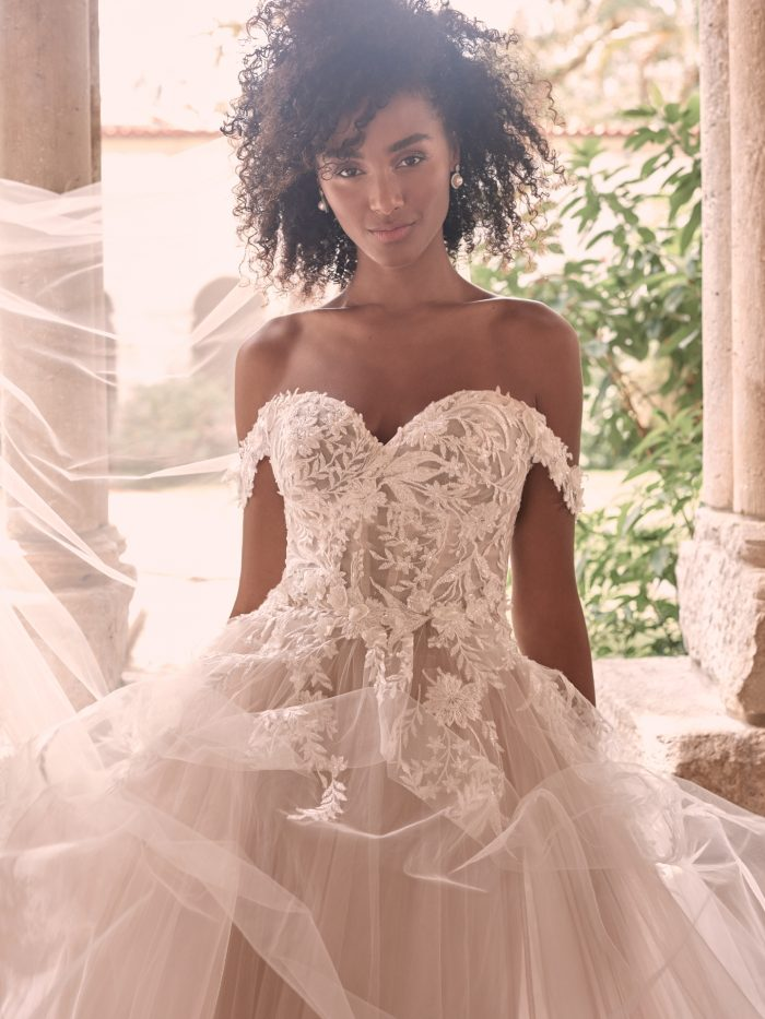 Black Model Wearing Dreamy Ball Gown Wedding Dress with Bridal Veil Called Orlanda by Maggie Sottero