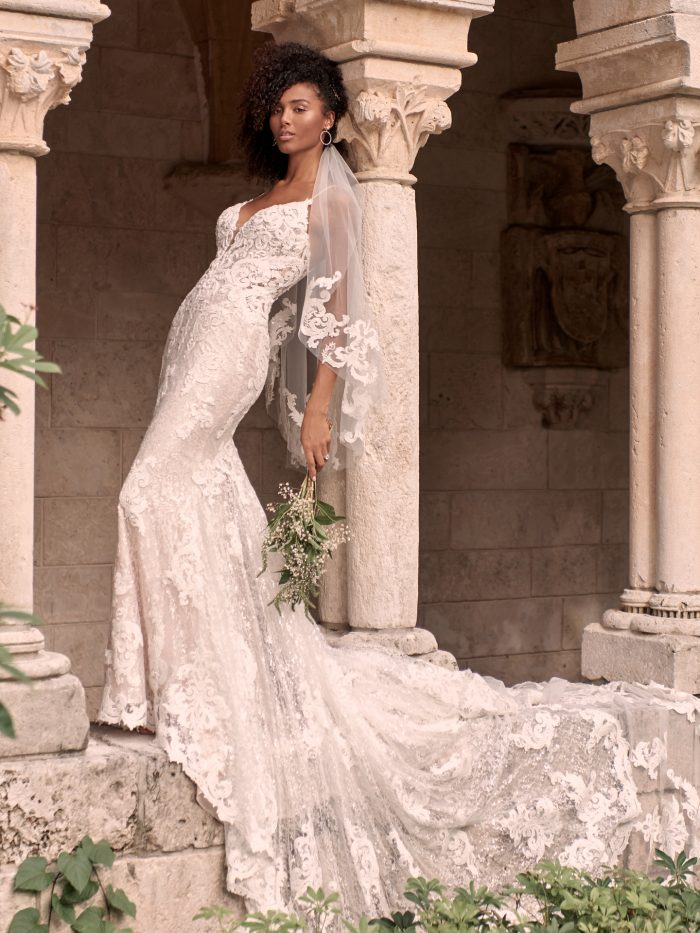 Black Model Wearing Lace Wedding Gown and Fingertip Length Lace Wedding Veil Called Tuscany Royale by Maggie Sottero