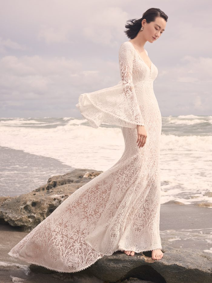 Bride on Beach Wearing Vintage Lace Wedding Dress with Bell Sleeves Called Benson by Sottero and Midgley